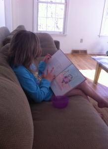 My little reader and budding artist.