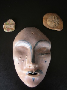 mask and stones